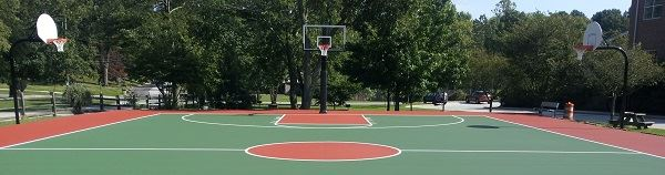 Outdoor Basketball Court Surrounded by Trees